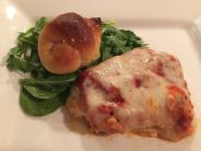 eggplant-rollatini-served-with-mixed-greens-and-a-garlic-knot