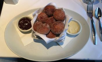 Ricotta donuts with chocolate and vanilla dipping sauces