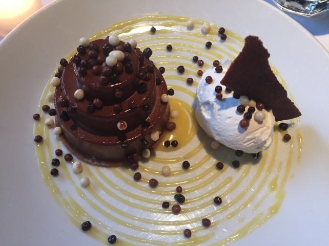 Dark chocolate mousse with passion fruit curd and chantilly cream